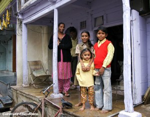 A family in front of their house in the city of Maneshwar