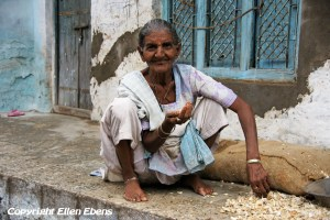 An old woman peeling garlic in the city of Maneshwar