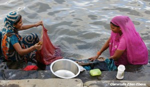 Women washing clothes in the river at the city of Maneshwar
