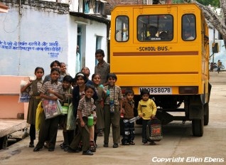 Schoolchildren with their school bus, Maneshwar