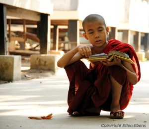 Young monk studying at the Mahagandayon Kyaung Monastery, Amarapura