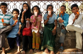 Children eating an ice cream in the city of Bijapur