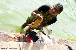 Woman washing clothes at the ghats at the small town of Badami
