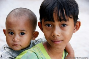 A boy with his baby brother, Bagan