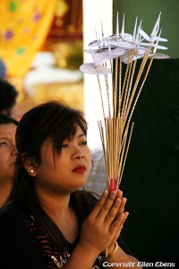 Yangon, woman praying at the Swedagon pagoda