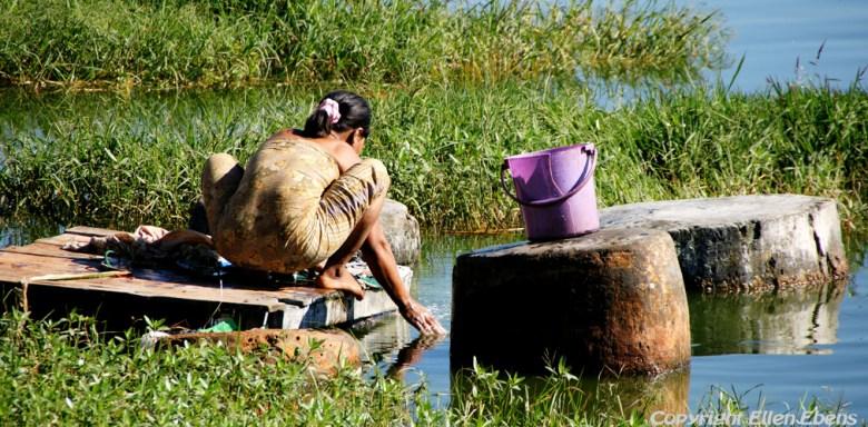 Pindaya, woman washing clothes at Pindaya Lake