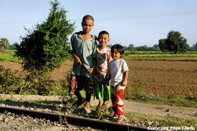 On road from Mandalay to Monywa, young boys on the railroad
