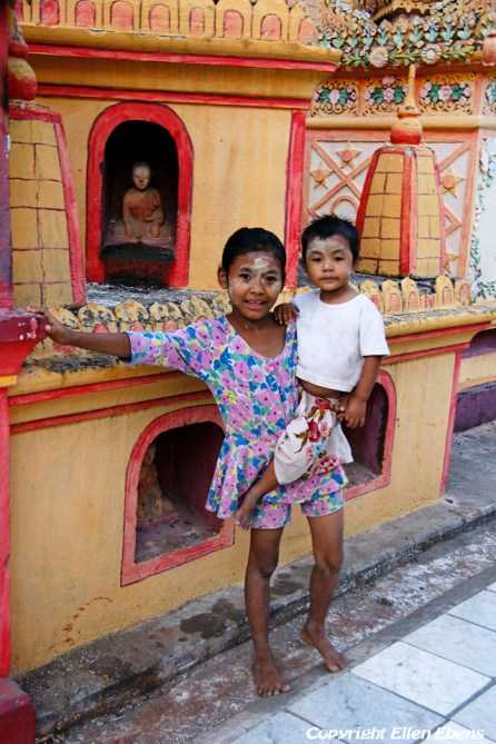 Near Monywa, a young girl holding her little brother at the Thanboddhay Pagoda