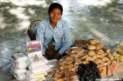 Near Mandalay, saleswoman at the Kaunghmudaw Pagoda