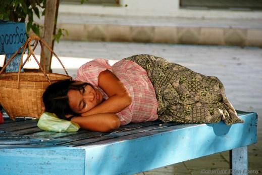 Near Mandalay, woman taking a nap at the Kaunghmudaw Pagoda