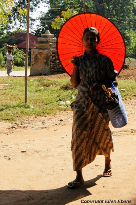 Mingun, woman with umbrella against the sun