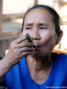 On the road from Bagan to Pyay, a woman smoking a cheroot