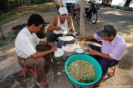 Pyay, men preparing food at the roadside