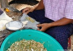 Pyay, men preparing food at the roadside