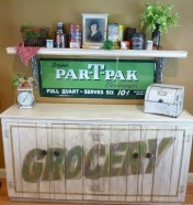 Distressed cabinet gets a new lighter finish and personality with signage by Ellen Leigh