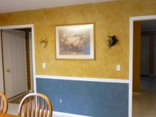Colorwahsed upper wall, plaster and colorwashed lower wall by Ellen Leighll