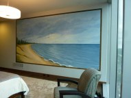 Peaceful Beach covers nearly a full wall in a master bedroom. Frame is painted on the wall to match the wood floor. Mural by Ellen Leigh