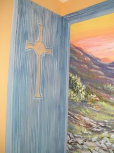 Detail of Arizona Window side wall with shutter painted to extend the work. Mural by Ellen Leigh