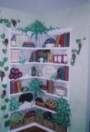 Corner Shelves with family favorite items and books, softly colorwashed walls and grapevines. Mural by Ellen Leigh