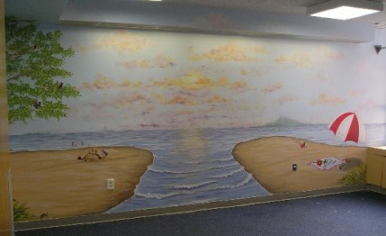 Beach scene in pediatric playroom. All walls painted with various Great Lakes region beach scenes, floral and fauna. Mural by Ellen Leigh