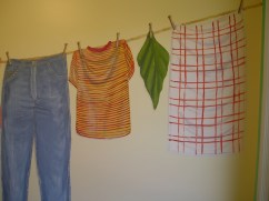 Laundry Line clothes painted hanging on a line mural by Ellen Leigh
