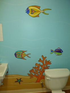 Plenty of tropical fish cartoons in the kids' bathroom at the day care. Mural by Ellen Leigh.