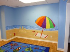 Toddler room beach scene in a day care. Mural by Ellen Leigh