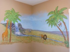 Savannah nursery mural with lion, monkey giraffe and elephant, waterfall in the back ground. Mural by Ellen Leigh