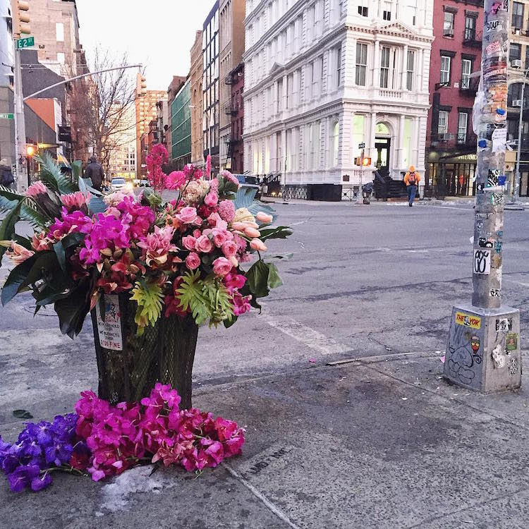 trash cans filled with flowers new york