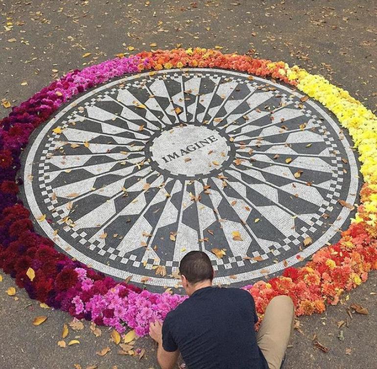 imagine memorial covered in flowers new york