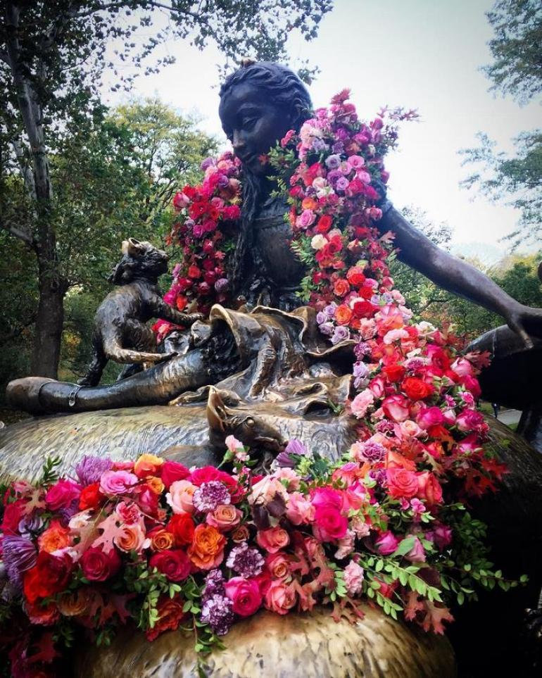 central park statue covered in flowers new york