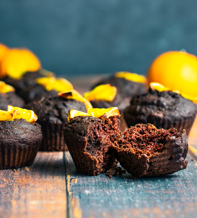 chocolate orange muffins placed on table, one split in half