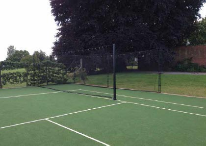 Cricket net as part of tennis court by EnTC courts.