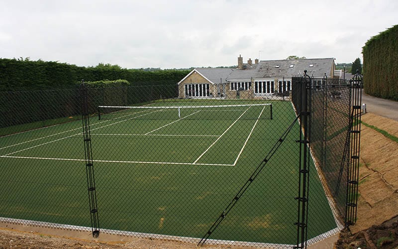 Mitred corners reduce the necessary footprint for a tennis court