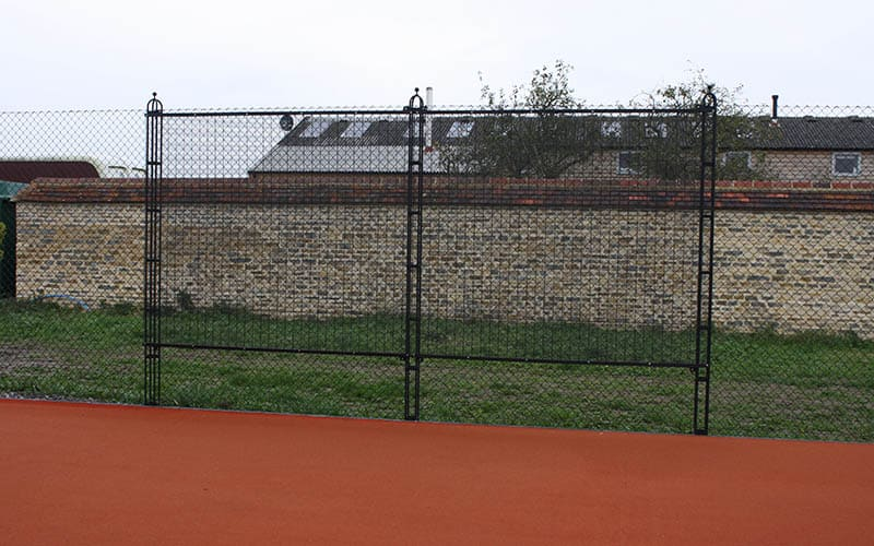 Double practice fence by Elliott Courts is unobtrusive.