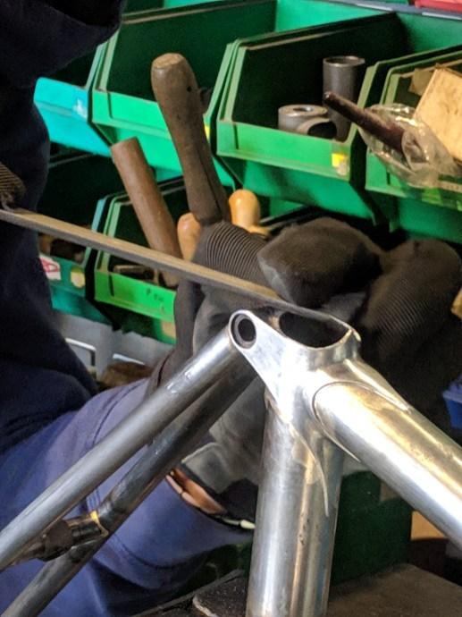 filing the seat lug
