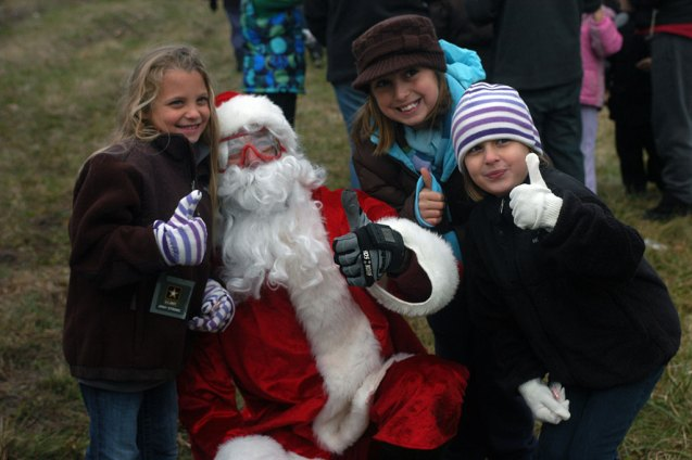 Pose with Santa at Ellms Family Christmas Tree Farm.