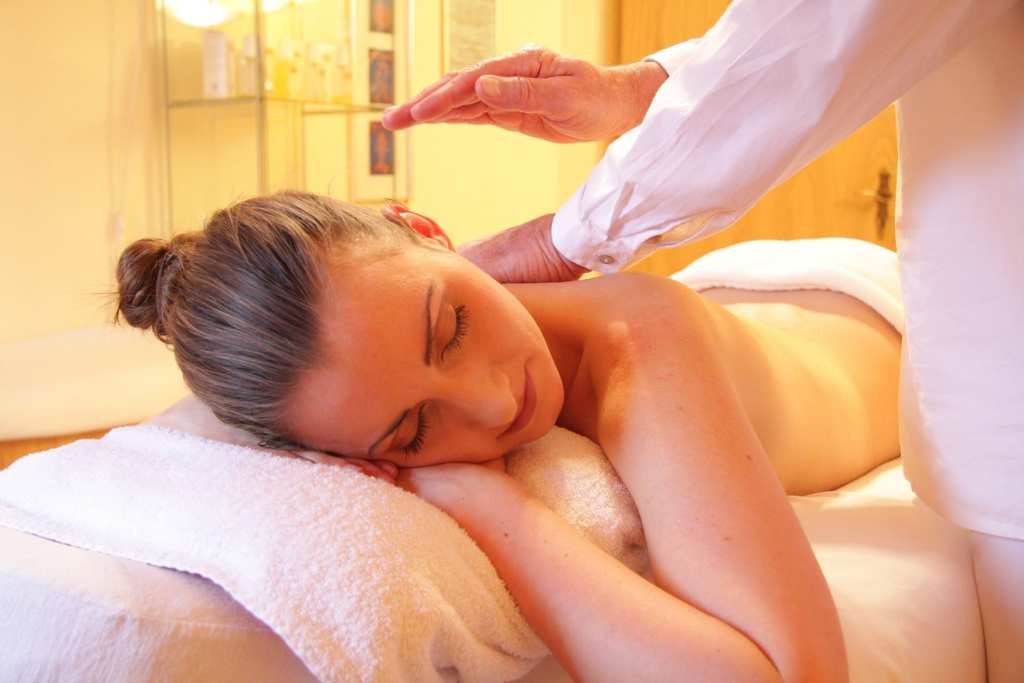 blog picture of lady turned receiving a massage