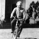 Albert Einstein on a bike.