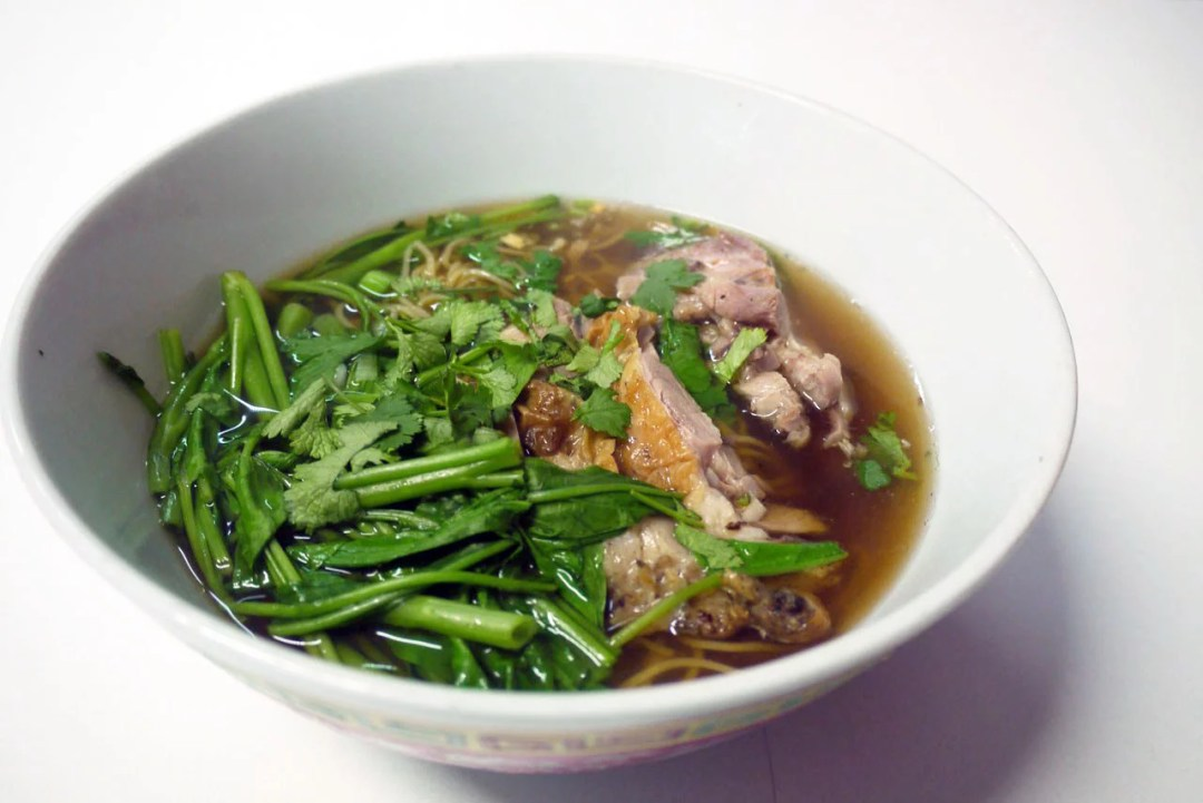 Menu item 4. Kuai Tiew Ped: Yellow noodles with duck and duck soup (£7)