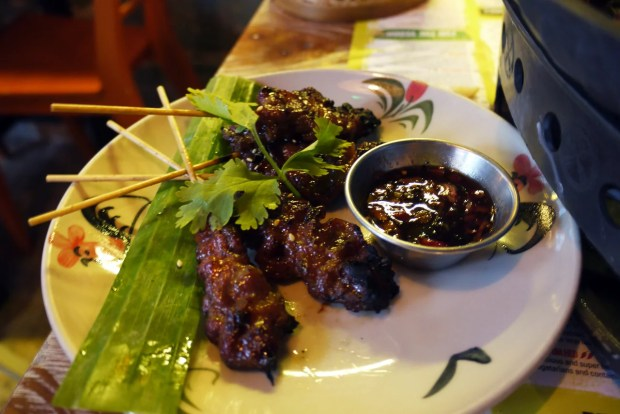 Moo ping - grilled marinated pork skewers with a tangy chilli dip