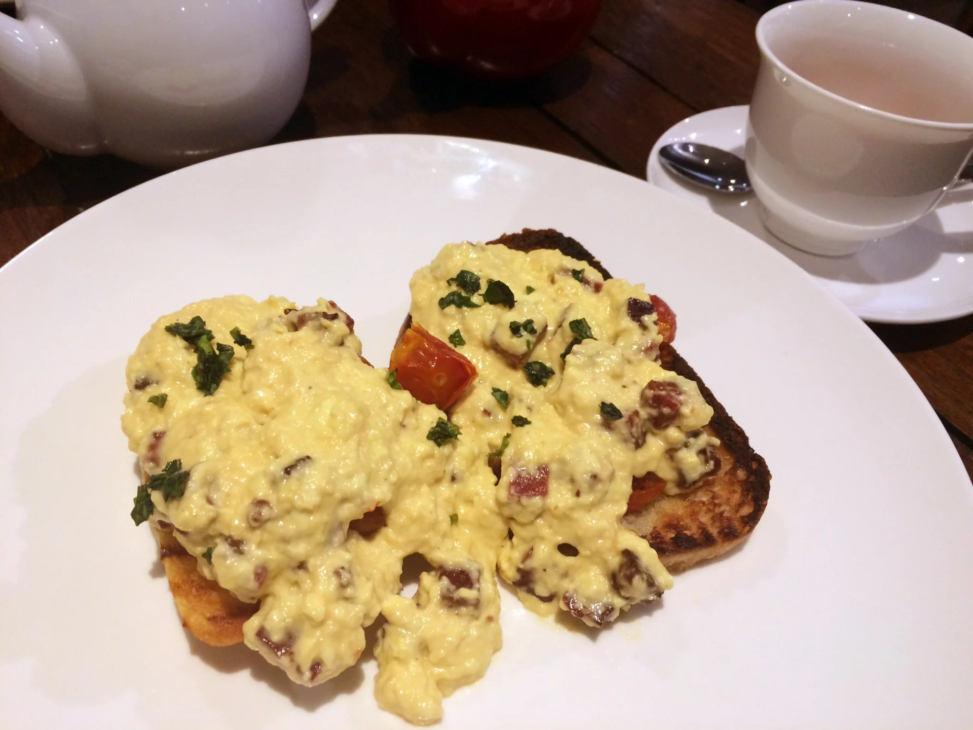 Balearic - Sourdough toast topped with crushed tomatoes and chorizo scrambled eggs