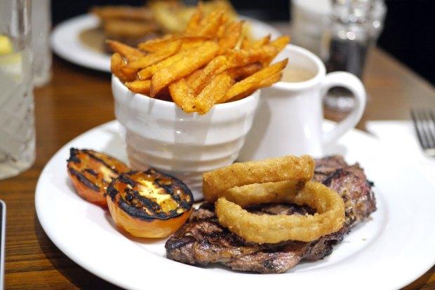 Char grilled 8oz sirloin steak (£17.45) & sauce (+£1.50) & sweet potato fries (+£1)