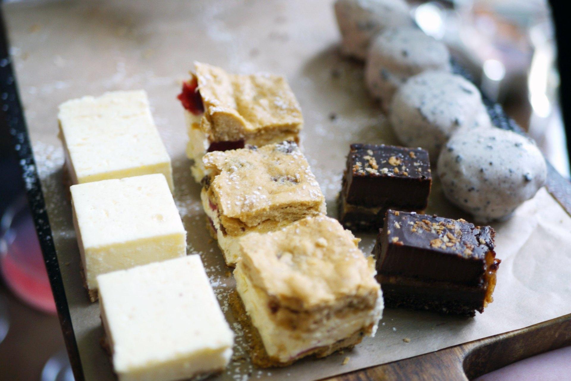 (L-R) Clotted cream cheesecake bites, strawberry scone bites, warm brownie bites and cookie crumb profiteroles.