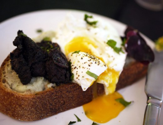Crusty sourdough topped with cauliflower and sorrel puree with poached egg and Morcilla black pudding