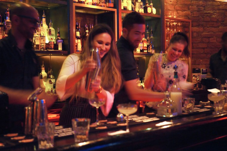 Another group make cocktails