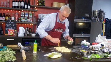 Paul Jagger applying the garlic butter to the bread