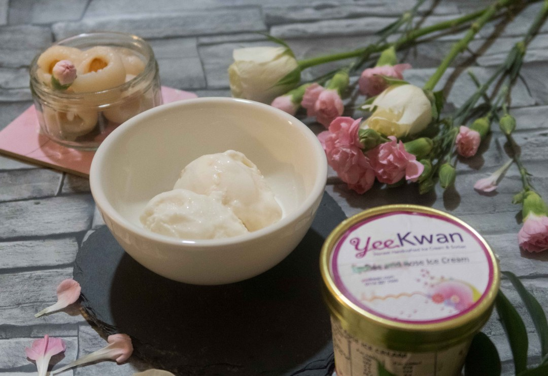 Yee Kwan's Lychee and Rose ice cream, in the tub and in a bowl, set against a background with roses