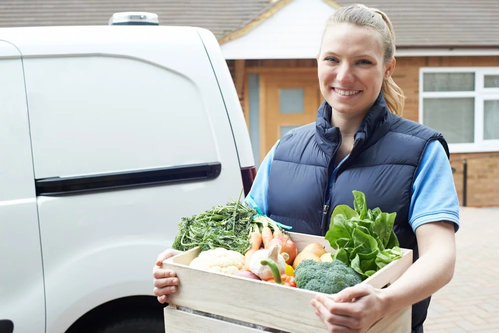 Farm to Fork driver with a box of veg