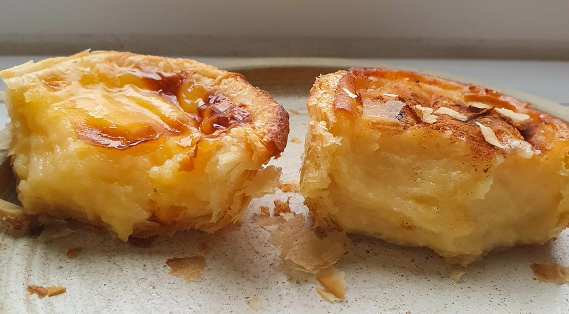 A side view of both tarts, half eaten. The Lidl tart is shown on the left whilst the Just Natas one is shown on the right. The latter has noticeably more filling.